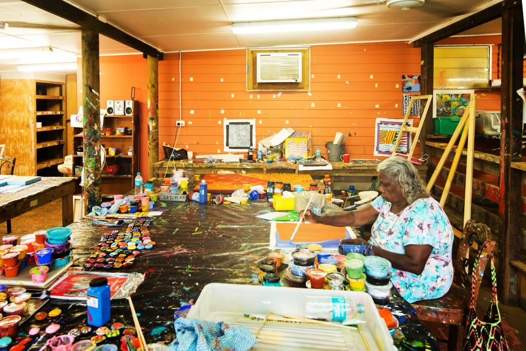 Artist at work in the HopeVale Arts & Cultural Centre